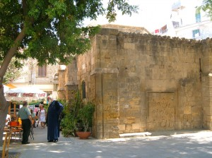 Nicosia-south-Orthodox-priest-near-the-Arablar-mosque-300x224